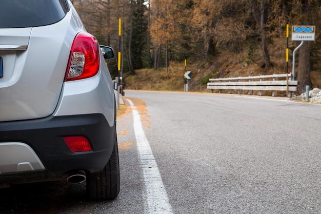 Car rental parking on the asphalt road ,tuscany italy.
