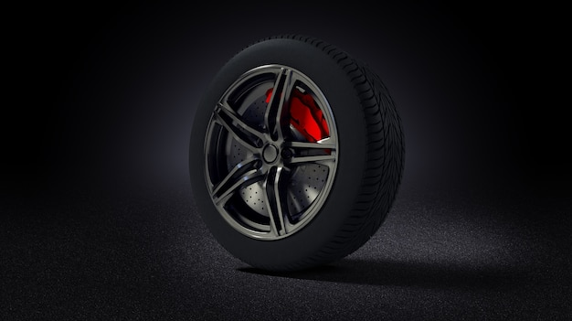 Car rim and tyre standing on asphalt road