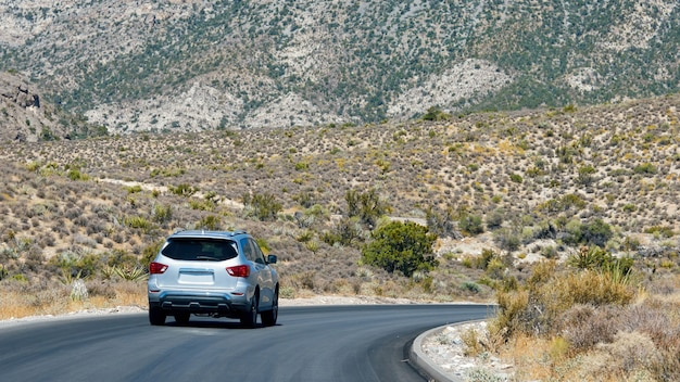 Car on road in red rock canyon, nevada, usa