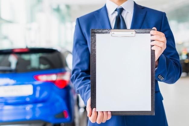 Car salesman showing clipboard template