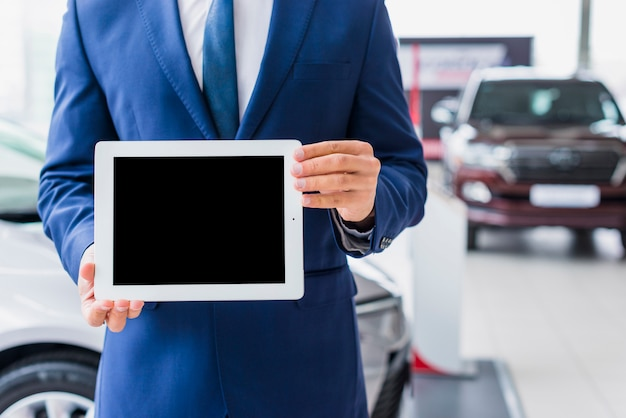 Car salesman with tablet