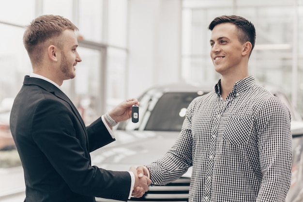 Car salesman working with a customer at the dealership