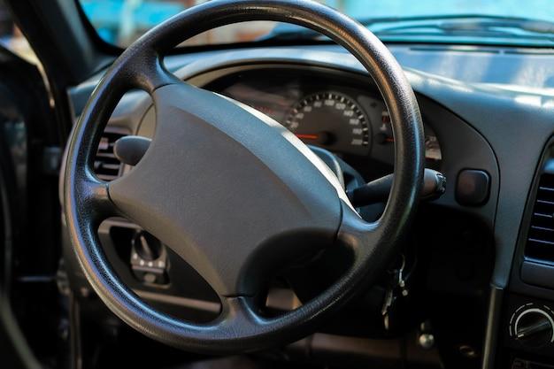 Car salon, black steering wheel