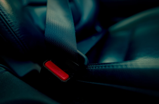 Car seat belt with red press button. fasten seatbelt for safety and security and protect life from car accident.