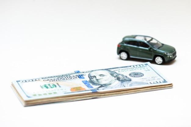 Car selling. small key, small car, money.