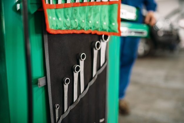 Car service tool box, spanners in the case closeup, professional instrument.