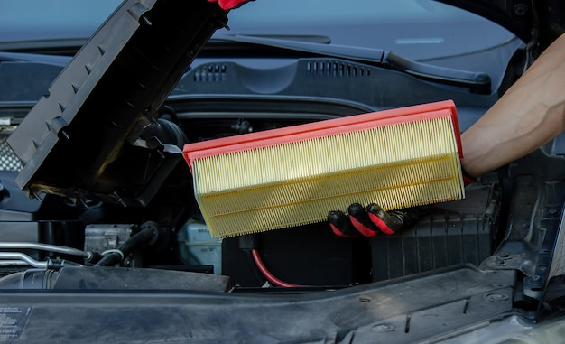 Car servicing, replacing of paper air filter