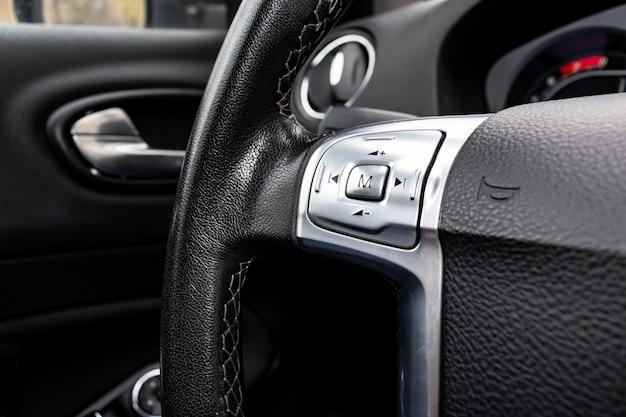 Car steering wheel close up, car interior