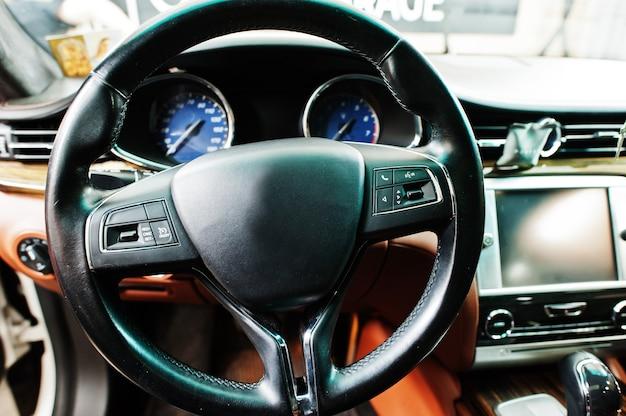 Car steering wheel interior of luxury transport.