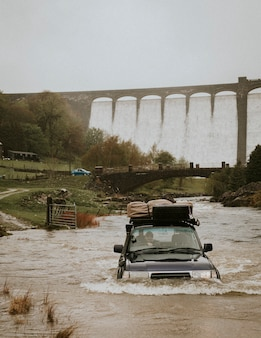 Car stuck in a flood near the dam structure
