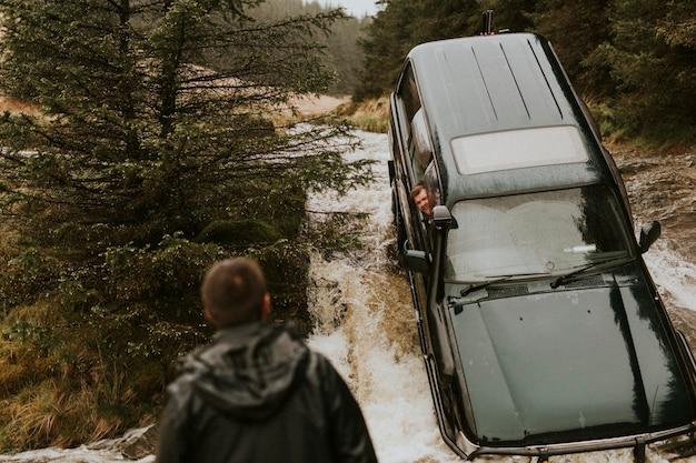 Car stuck in a stream waiting for rescue Premium Photo