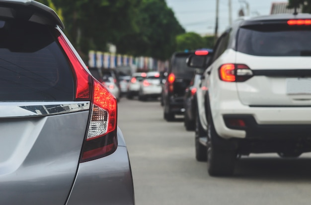 Car tail lights, traffic jams during rush hour.