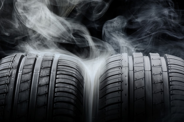 Car tires and smoke on black