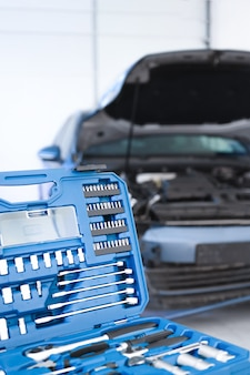 Car tools in a blue box closeup for the repair and maintenance of vehicles at the service