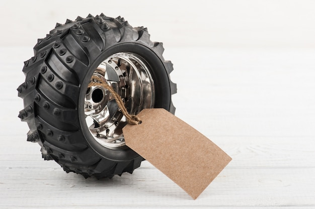 Car toy tire tied with tag