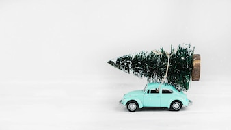 Car toy with fir tree on top