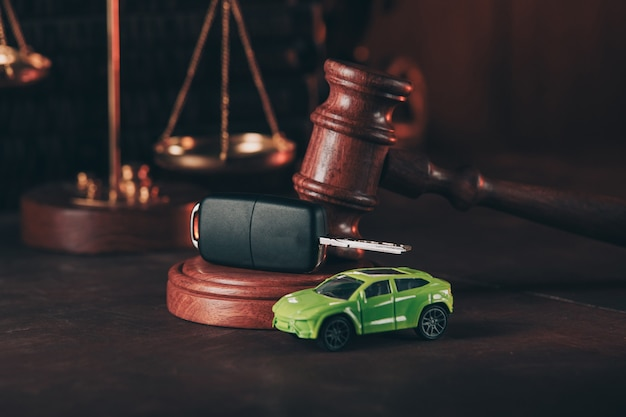 Car toy and wooden gavel. concept of selling a car by auction or accident sentence