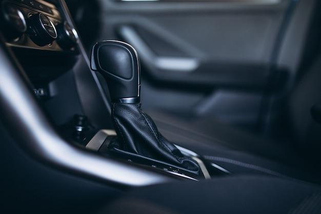 Car transmission inside a car salon close up