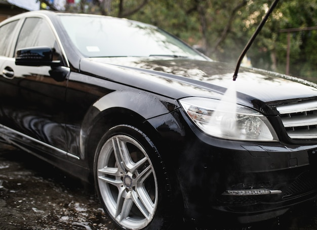 Car wash with pressurized water, car detailing (or valeting) concept.