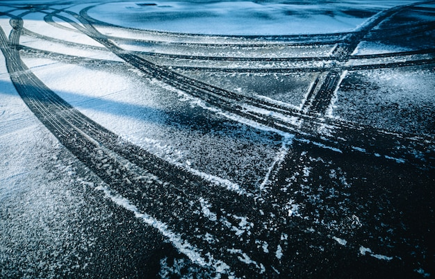 Car wheel on the snow season winter background abstract
