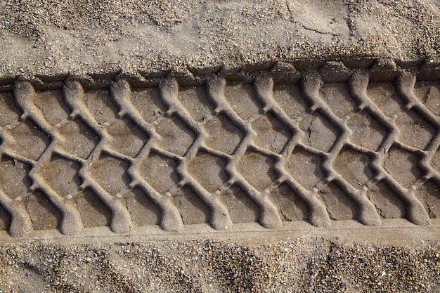 Car wheel tilres print footprint on the beach sand