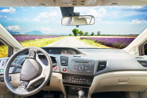 Car windscreen with country summer road