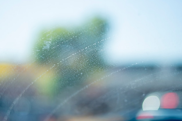 Car windshield with a period of water in a line