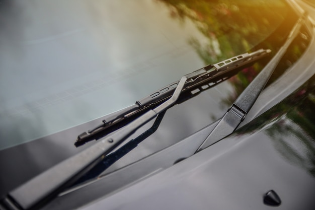 Car wiper of car parked on street sunlight background