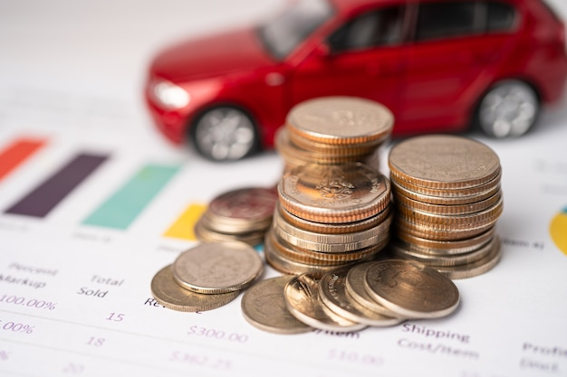 Car with coins on graph.