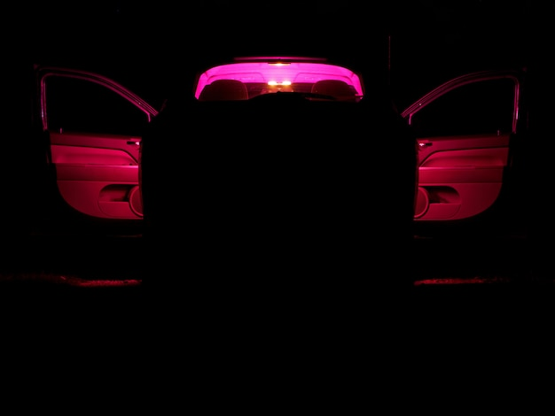 Car with a red light inside on a dark night