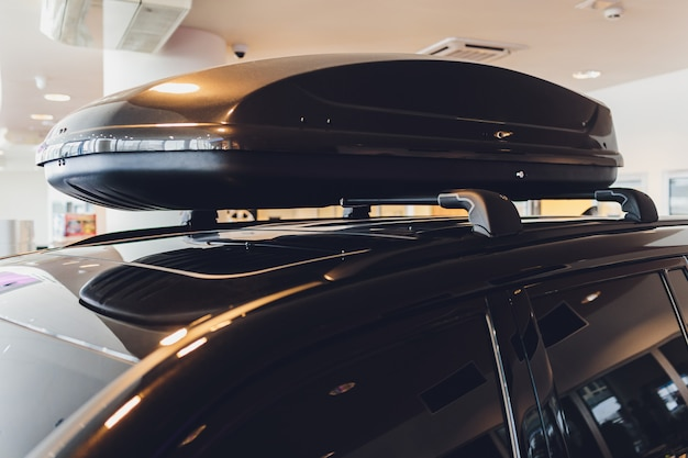 Car with the roof rack with cargo box.