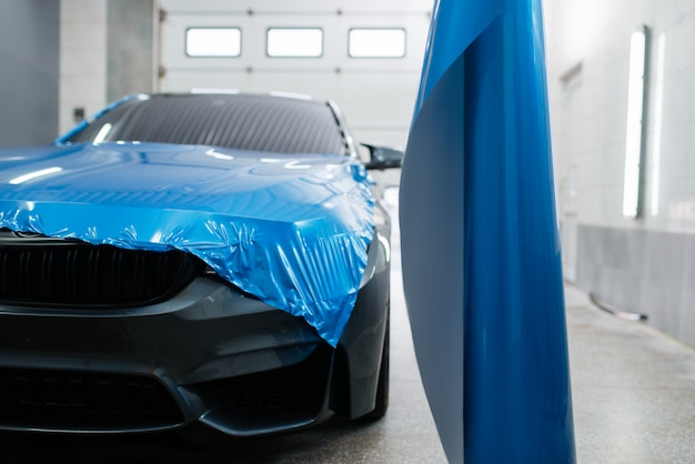 Car wrapping, protective vinyl foil or film installation on the vehicle, nobody. auto detailing. automobile paint protection, professional tuning