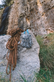 Carabiners and rope on rock