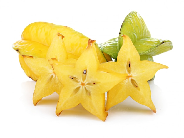 Carambola fruit with slices isolated on white