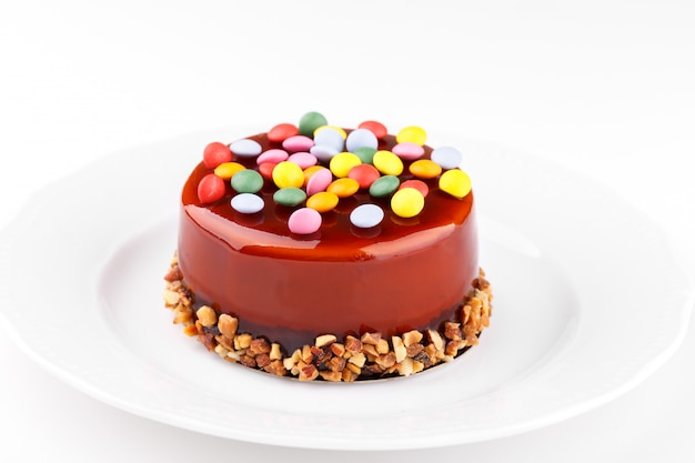 Caramel cake with candies