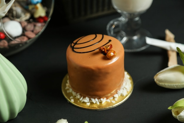 Caramel cake with chocolate decoration side view