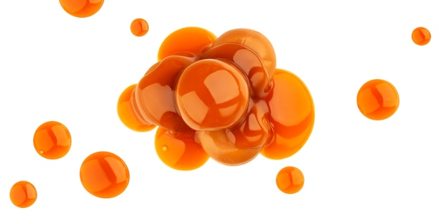 Caramel candies and caramel sauce isolated on white , top view