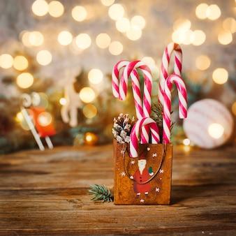 Caramel cane on christmas background