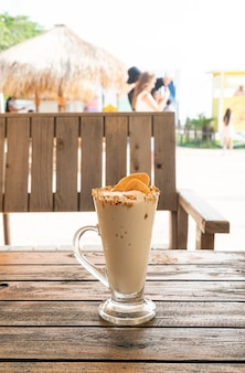 Caramel coffee nut smoothie milkshake glass in cafe and restaurant
