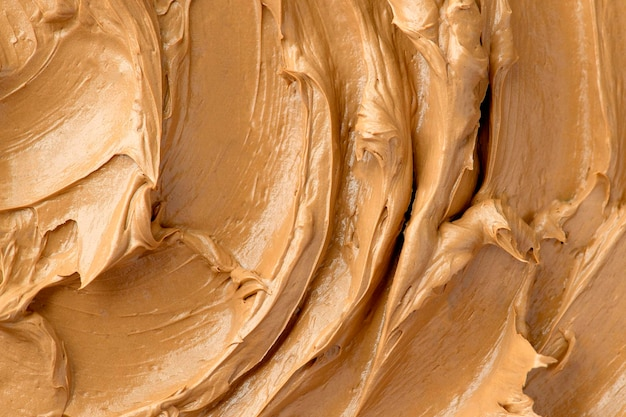 Caramel frosting texture background close-up