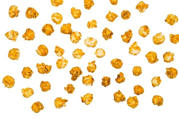 Карамель поп-кукуруза, изолированные на белом фоне.