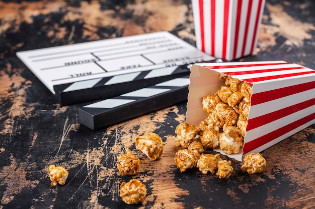 Caramel popcorn and wooden clapper
