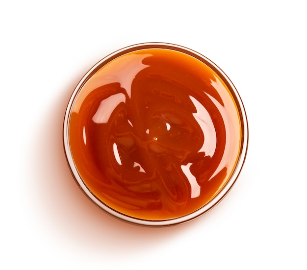 Caramel sauce isolated, top view