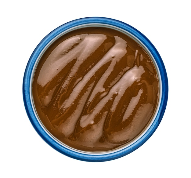 Caramel sauce isolated on white background top view