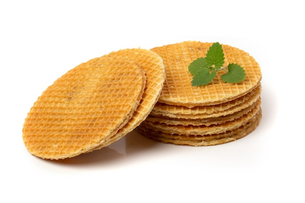 Caramel waffles are round isolated on a white background.