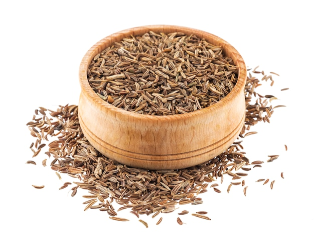 Caraway seeds in wooden bowl isolated on white background