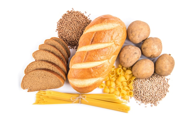 Carbohydrates of loaf, potatoes and groats isolated on white.