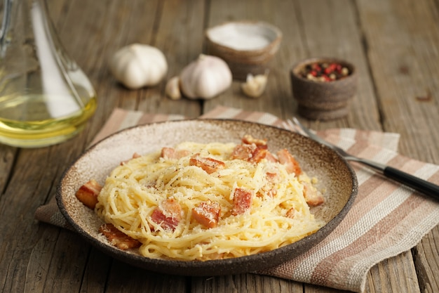 Carbonara pasta. spaghetti with bacon, egg, parmesan cheese. side view. traditional italian cuisine