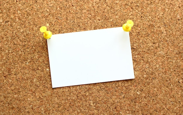 Card attached to the corkboard with a button reminder on the office board