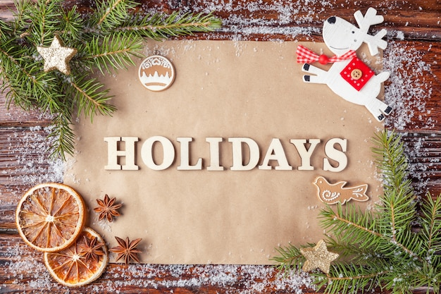 Card inscription holidays lined with wooden vintage letters,